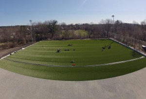 Overhead picture of turf being installed. Camera is facing south, RR tracks are to the right of the turf, Muraco Field is at the far end of turf, Aberjona River (and Leonard Field) are to the left.